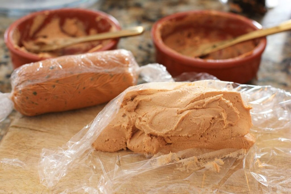 put some fish pate onto a square of plastic wrap